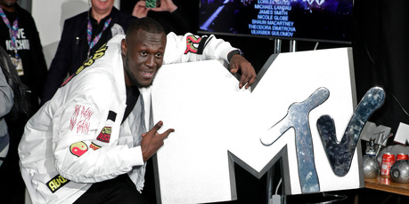 Rapper Stormzy poses with the award for the UK and Ireland Worldwide Act in the Winners Room during the MTV EMAs 2017. Photo / Getty