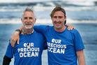Whanganui doctor Athol Steward with his son Jonathan post 400km beach trek. Photo/ Stuart Munro