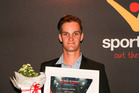 Waipa Sportsman of the Year, Te Awamutu's world champion mountain biker, Sam Gaze with his certificate.