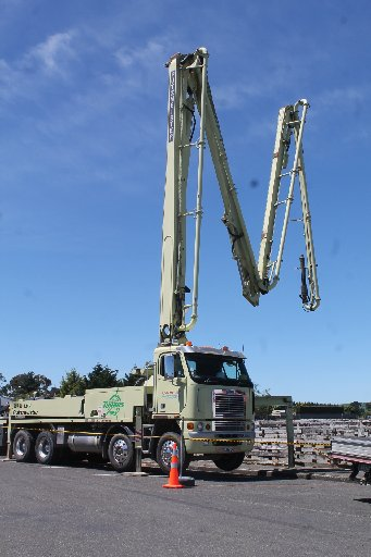 A spectacular sight as the concrete pump extends into Dannevirke's Sale Yards