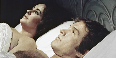 A scene showing Warren Beatty lying down next to Elizabeth Taylor, from the movie 'Only Game in Town', 1970. Photo / Getty