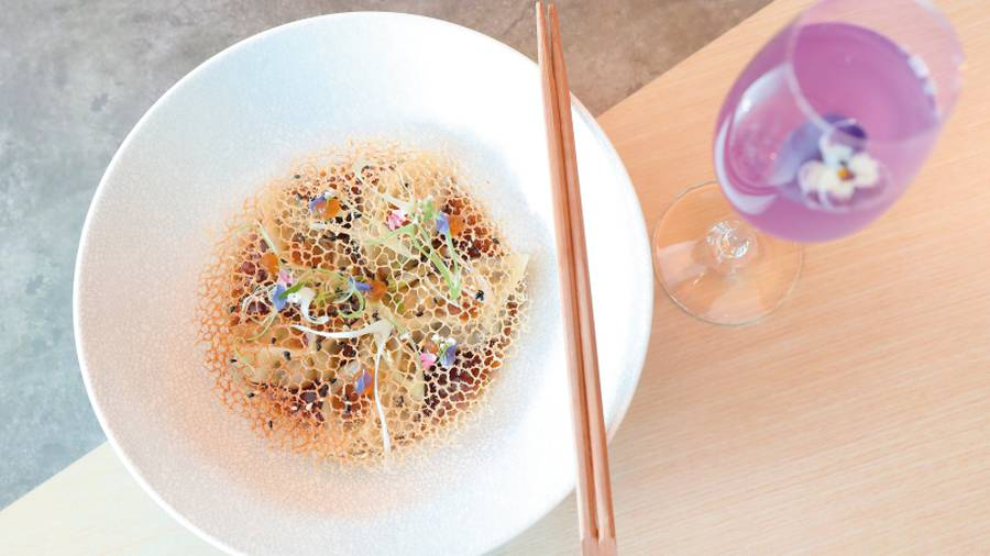 The shiitake and tofu gyoza, and the signature butterfly cocktail. Photo / Getty Images