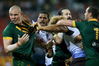 Kangaroo prop David Klemmer (left) comes under attention from Fiji's Tui Kamikamica and Eloni Vunakece after a cheap shot earlier on Jarryd Hayne in Brisbane last night. Photo/Photosport