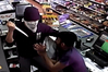 One of the offenders held a knife to the face of the sole shopkeeper on duty and demanded money. PHOTO / SUPPLIED