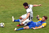 Bay United goal scorer Alex Palezevic (white) out muscles Southern United player Danny Ledwith for possession at Sunnyvale Park, Dunedin, yesterday. Photo/Peter McIntosh, ODT