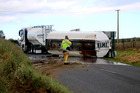Molasses is oozing onto the road after the truck's trailer rolled. Photo / Colin Thorsen