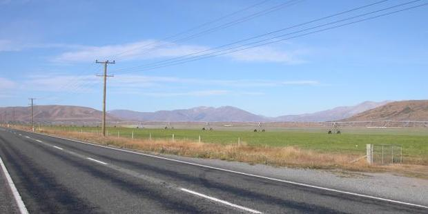 Ensuring water from irrigators stays on the paddock and not on the road not only saves water but also reduces accidents. Photo: Central Rural Life Files