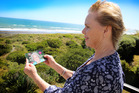 Joan Johnston holds a photo of her late mother who died not long after three falls. Photo/Stuart Munro