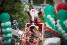 Santa greets thousands of people at this year's Auckland Farmers Santa Parade. Photo / Greg Bowker