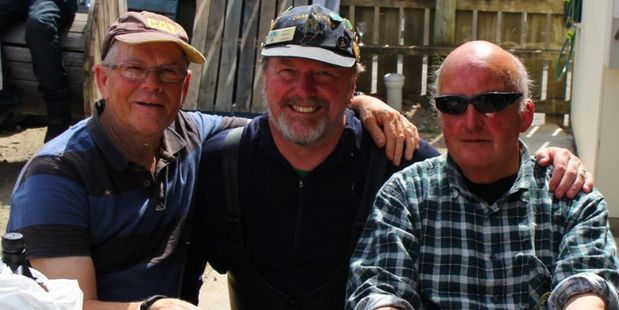 THREE AMIGOS: Lynn Southee, left, Grant McRae and Trevor Ward celebrate the end of last year's Woodville Lions ride at Akitio. They have ridden in every Coast to Coast. Photo/supplied