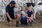 Sean Baty, and Lydia Baty, with their son Max (left) and Harrison at their goat farm near Havelock North.