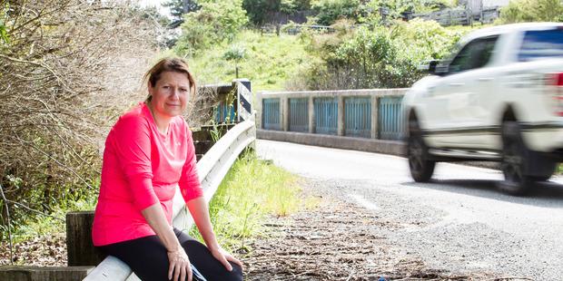 Loading Rodney Board local member Louise Johnston in Blackbridge Road, Dairy Flat, Rodney, showing the single land bridge. Photo / File