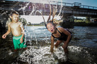 Luke Moore, 5, and Jade Moore, 7, cooling off in the Waipawa River in March. Photo / Paul Taylor