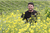 Supernatural Wine Co. viticulturist and winemaker Hayden Penny at the Millar Road vineyard among a green manure crop including mustard, buckwheat and phycelia. Photo / Duncan Brown