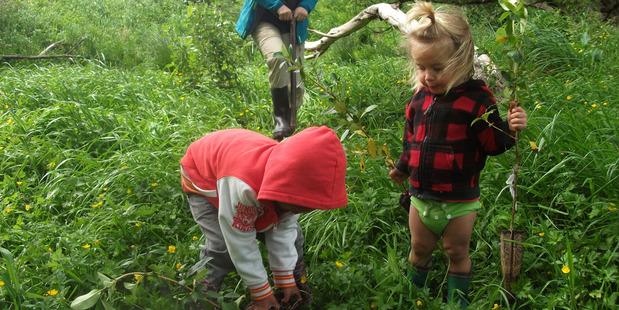 Children help with planting at Kaitiaki Farm. Photo / Supplied