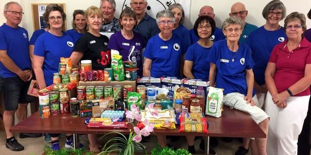 The Tai Chi group with some of the groceries collected to help those in need. Photo / Supplied