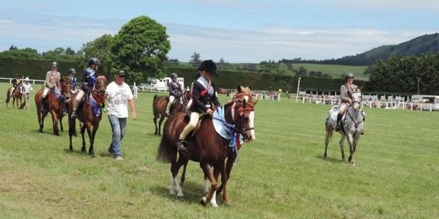 Young equestrians show off their skills - and ribbons - in the Grand Parade.