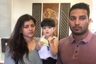 A young Indian couple facing deportation with their 2-year-old daughter still haven't told their parents of the fate that has been hanging over them for nine months.