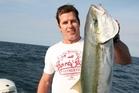 Steve Devine with a  kingfish caught on live bait. Photo / Geoff Thomas