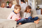 Children using smartphones and tablets from an early age can have both troubling and positive consequences, a leading academic says. Photo / 123RF
