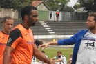 Tasman United captain Paul Ifill and coach Richard Anderson lead despondent teammates off Memorial Park, Palmerston North, yesterday. PHOTO/Anendra Singh