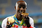 Britain's Sir Mo Farah celebrates completing the 5000-10,000m double at the Rio Games. Photo / AP
