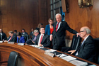 Senate Health, Education, Labour, and Pensions Committee member Senator Orrin Hatch, centre, takes his seat on Capitol Hill for the committee's session on Betsy DeVos. Photo / AP