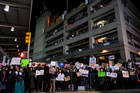 Protesters assemble at John F. Kennedy International Airport in New York, Saturday. Earlier in the day two Iraqi refugees were detained while trying to enter the country. Photo / Craig Ruttle