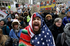 Izzy Berdan, of Boston, centre, chants slogans with other demonstrators during a rally against President Donald Trump's order that restricts travel to the US. Photo / AP