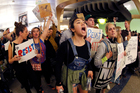 Demonstrators chant inside Tom Bradley International Terminal in Los Angeles as protests against President Donald Trump's executive order continue. Photo / AP