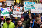People protest against President Donald Trump's travel ban on refugees and citizens of seven Muslim-majority nations in Seattle. Photo / AP