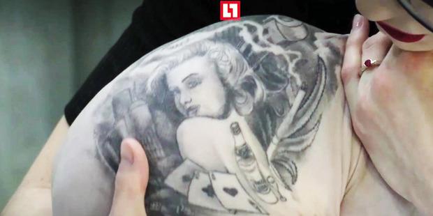 Aleksandr's wife with the tattooed cat. Photo / Australscope