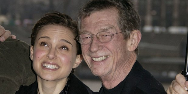 Natalie Portman and John Hurt shelter from the rain together. Photo / Getty Images