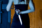 After repeatedly asking if the man, 29, was a murderer, she took out her own knife. Photo / Getty Images