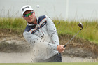 Ryan Foxplays out of a bunker during the World Cup of Golf at Kingston Heath Golf Club. Photo / Getty Images