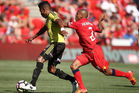 Roy Krishna of the Wellington Phoenix gets away from Henrique of Adelaide United. Photo / Getty