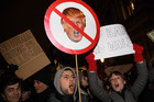 Demonstrators holding placards chant during a protest outside Downing Street against US President Donald Trump's ban on travel from seven Muslim countries. Photo / Getty