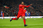 Georginio Wijnaldum of Liverpool celebrates scoring his side's goal to make it 1-1 during the Premier League match against Chelsea. Photo/Getty Images