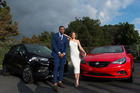 Quarterback Cam Newton of the Carolina Panthers and model Miranda Kerr pose for a photo at 'Buick Super Bowl ad. Photo/Getty Images