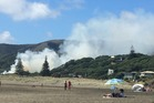 Three fire trucks have been called to a fire near Piha Beach on Auckland's West Coast. Photo / D'Arcy Waldegrave