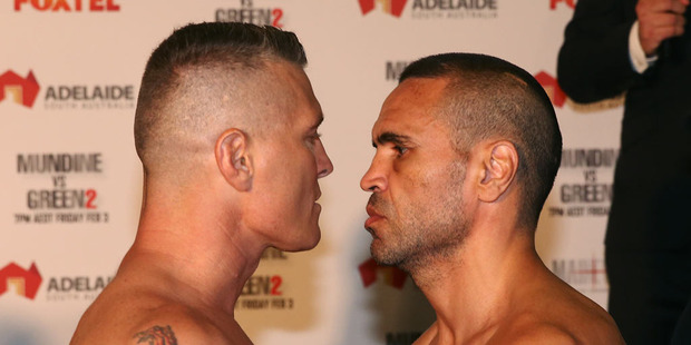 Australian boxers Danny Green and Anthony Mundine face off during the official weigh in ahead of their Friday night bout. Photo / Getty Images.