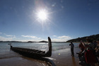 Tourists admire a waka sitting on the beach during Waitangi Day celebrations on February 6, 2013. Photo / Supplied