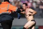 A streaker invades Eden Park during today's Black Caps v Australia match. Photo / www.photosport.co.nz