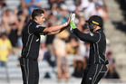 Mitchell Santner celebrates with Tom Latham after stumping Pat Cummins. Photo / www.photosport.co.nz