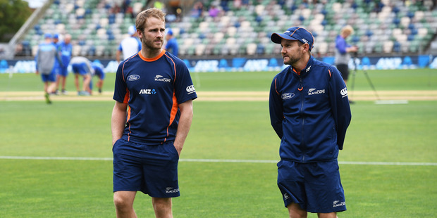 NZ Captain Kane Williamson and coach Mike Hesson inspect the wicket during a rain delay. International One Day Cricket. Photo / Photosport.co.nz