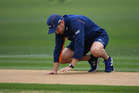 Coach Mike Hesson inspects the wicket during a rain delay at McLean Park, Napier, New Zealand. Photo / Photosport.co.nz