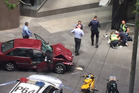 The scene in Bourke Street, Melbourne, where the driver of the car is arrested by police. Photo / AP