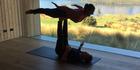 Stephanie Holmes doing acro-yoga at Aro Ha. Photo / Supplied