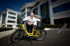 Mercury Energy chief executive Fraser Whineray with an E-bike at the company's head office in Newmarket. Photo / Dean Purcell.