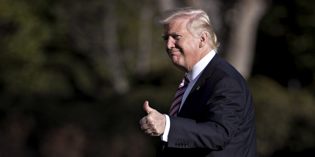 US President Donald Trump gestures while walking towards the White House after arriving on the South Lawn of the White House in Washington. Photo / AP